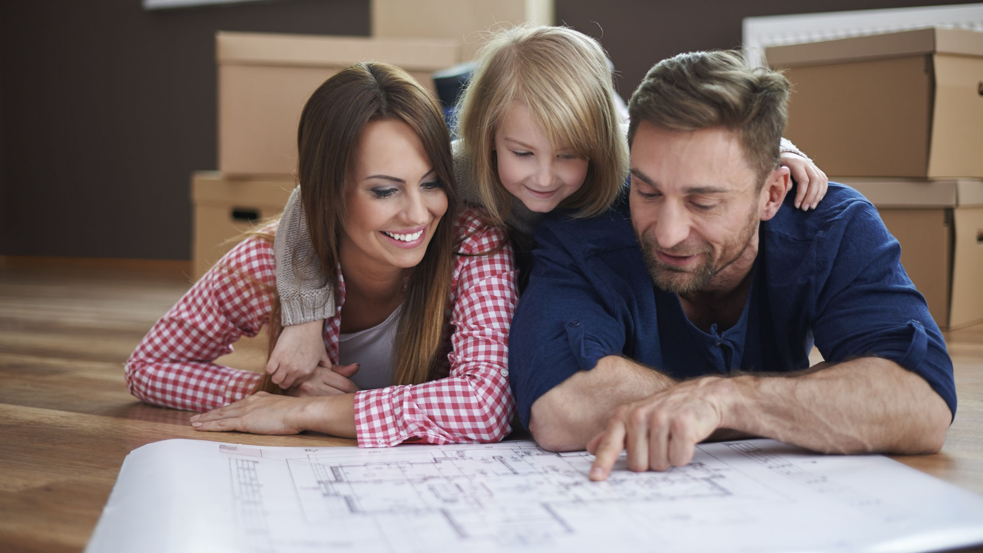 Family looking at House plans